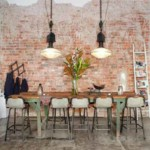 Dining room with custom rustic brick wall.