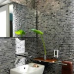 Gray brick wall in bathroom.