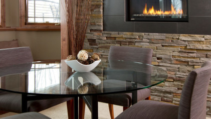 Electric fireplace in stone wall.