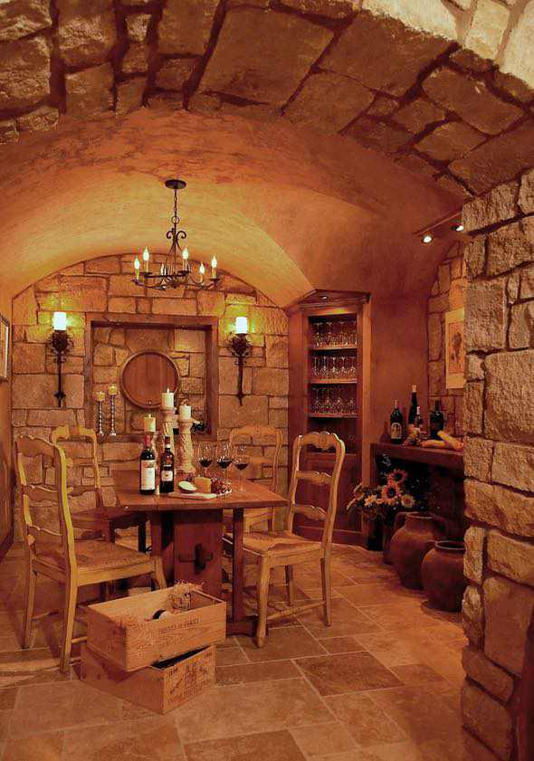 wine cellar with dim lighting made of large stone