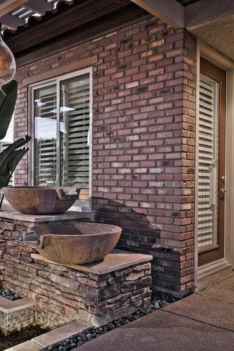 Hebron landscaping inspiration stone wall and pot holder